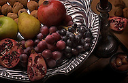 Pomegranates, grapes, pears, apples, walnuts and dates are served on a silver platter, creating a rustic yet elegant medieval tabletop tableau. (Photo by Carmen K. Sisson/Cloudybright)