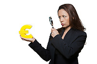 Portrait of expressive woman surveying Euro in studio isolated on white background
