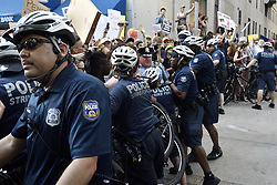 Police and protestors clash after a goverment vehicle, driven by USSS agents attemtps to drive trough the crowd of protestors, near Rittenhouse Square, in Center City Philadelphia, PA, on June 19, 2018. <br /> Vice President Mike Pence is visiting an event organized by Republican Governors Association (RGA) at a nearby hotel.