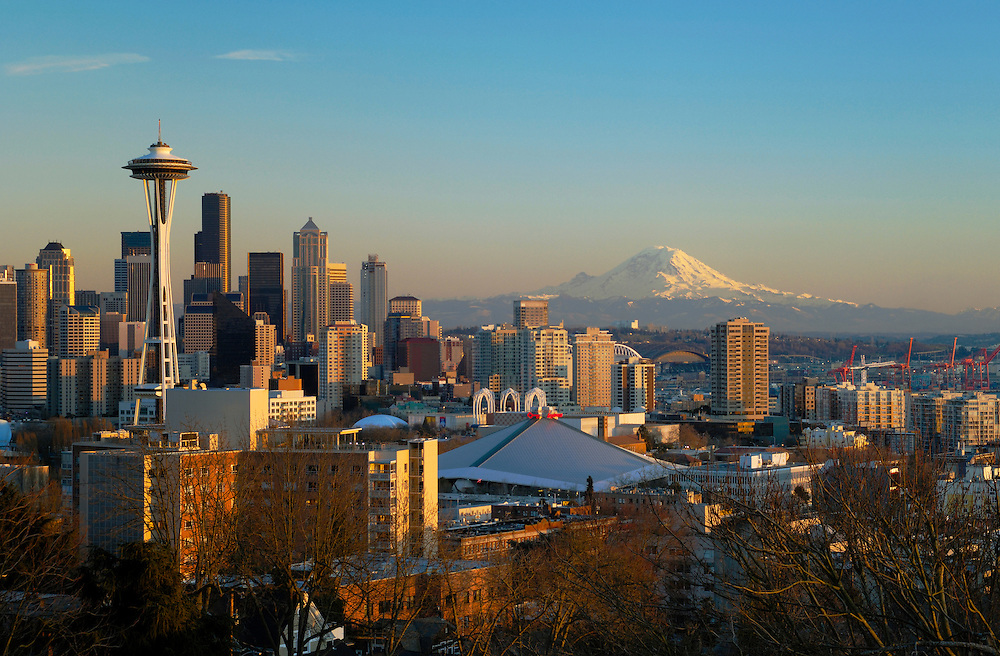 City skyline at sunset with the Space Needle, downtown and Mount Rainier from Queen Anne Hill; Seattle, Washington.