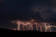A fine art photograph of multiple lightning strikes at sunset over El Rio Grande del Norte National Monument. New Mexico. USA.<br /> <br /> AVAILABLE AS:<br /> <br /> Size 20&rdquo; x 16&rdquo; (50.8cm x 40.6cm approx)*<br /> Edition of ONLY 100 at this size.<br /> US$350 + shipping<br /> <br /> Hand printed in Taos, New Mexico, USA by Taos Print and Photography Services using archival inks and fine art paper. signed and numbered by hand.<br /> <br /> Contact jim@jimodonnellphotography.com to order
