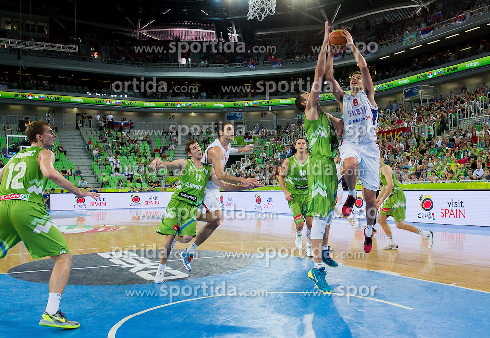 Mirza Begic of Slovenia vs Nemanja Bjelica #8 of Serbia during basketball match between National teams of Serbia and Slovenia in 5th to 8th place game at Day 16 of Eurobasket 2013 on September 19, 2013 in Arena Stozice, Ljubljana, Slovenia. (Photo by Vid Ponikvar / Sportida.com)
