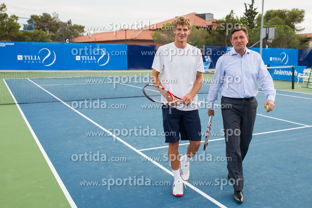 Blaz Rola of Slovenia and Borut Pahor, president of Slovenia playing tennis during Day Six of tennis tournament ATP Challenger Tilia Slovenia Open 2013 on July 7, 2013 in SRC Marina, Portoroz / Portorose, Slovenia. (Photo by Vid Ponikvar / Sportida.com)