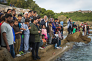 LESVOS, GREECE - NOV 6: Refugees gather to commemorate the lives of the thousands of people who have drowned in the Aegean Sea trying to reach the safety of European shores in Mytilene on November 6th, 2016.