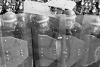 Police behind riot shields at Orgreave, 1984 Miners Strike..© Martin Jenkinson, tel 0114 258 6808 mobile 07831 189363 email martin@pressphotos.co.uk. Copyright Designs & Patents Act 1988, moral rights asserted credit required. No part of this photo to be stored, reproduced, manipulated or transmitted to third parties by any means without prior written permission