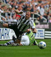Fotball<br /> England 2005/2006<br /> Foto: SBI/Digitalsport<br /> NORWAY ONLY<br /> <br /> Newcastle United v Deportivo La Coruna<br /> Intertoto Cup.<br /> 03/08/2005.<br /> Newcastle's Alan Shearer (L) is felled by Deportivo's Joan Capdevila (R).