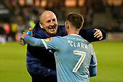 Accrington Stanley manager John Coleman hugs Jordan Clark (7) of Accrington Stanley at full time after a 3-0 win over Plymouth Argyle during the EFL Sky Bet League 1 match between Plymouth Argyle and Accrington Stanley at Home Park, Plymouth, England on 22 December 2018.
