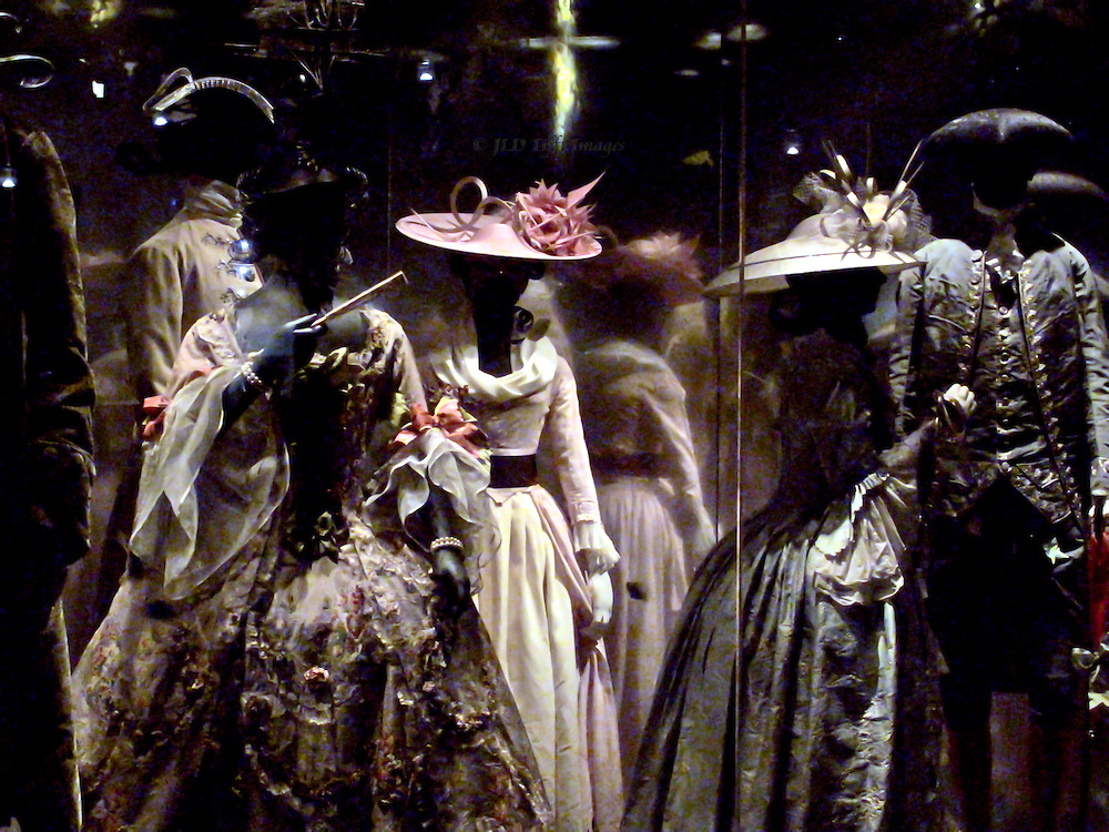 Figures in a glass case at the Lon don Museum are dressed in Victorian era costumes in a setting meant to suggest the then popular Vauxhall Park.