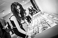 Cher Lloyd signs posters backstage on December 8, 2012 during the Y100 Jingle Ball at BB&T Center in Sunrise, Florida