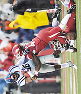 Ole Miss Rebels wide receiver Cody Core (88) is tackled by Arkansas Razorbacks linebacker Martrell Spaight (47) and Arkansas Razorbacks linebacker Josh Williams (42) at Donald W. Reynolds Razorback Stadium in Fayetteville, Ark. on Saturday, November 22, 2014.