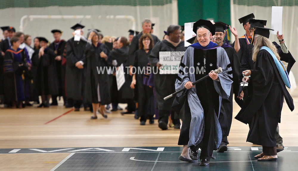 Robert Schultz, vice president for academic and studentsffairs at SUNY Sullivan leads staff and faculty into the fieldhouse for convocation on Monday, Sept. 9, 2013.
