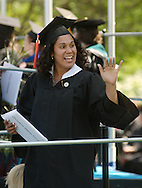 Middletown, NY - A graduate signals to someone in the audience after receiving her diploma during the 58th commencement at Orange County Community College on May 17, 2008.
