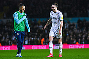Leeds United defender Luke Ayling (2) celebrates at full-time with Leeds United forward Tyler Roberts (11) during the EFL Sky Bet Championship match between Leeds United and Bristol City at Elland Road, Leeds, England on 15 February 2020.