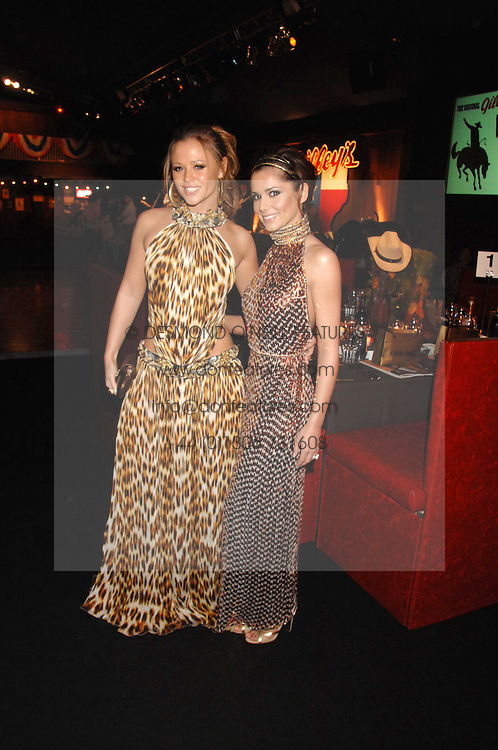 Left to right, KIMBERLEY WALSH and CHERYL COLE at the London Red Cross Ball themed 'Honky Tonk Blues' held at 99 Upper Ground, London SE1 on 21st November 2007.<br /><br />NON EXCLUSIVE - WORLD RIGHTS