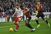 Sheffield United forward Billy Sharp under attack  from and Bradford City midfielder Lee Evans Bradford City defender Greg Leigh  during the Sky Bet League 1 match between Sheffield Utd and Bradford City at Bramall Lane, Sheffield, England on 28 December 2015. Photo by Ian Lyall.