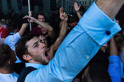 Fans celebrate England's one goal lead at half time outside Riley's Sports Bar on Haymarket. London, July 11 2018.