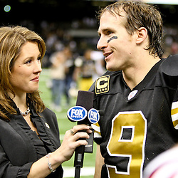 November 6, 2011; New Orleans, LA, USA; Fox sideline reporter Jennifer Hale interviews New Orleans Saints quarterback Drew Brees (9) following a win over the Tampa Bay Buccaneers at the Mercedes-Benz Superdome. The Saints defeated the Buccaneers 27-16. Mandatory Credit: Derick E. Hingle-US PRESSWIRE