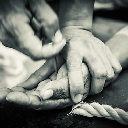 Detail of the hands of a crucified man while someone is removing the nails. San Fernando, Pampanga, Philippines.
