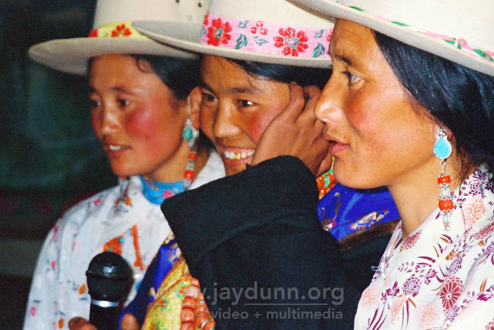 China, Xiahe, 2005. With all the enthusiasm a roomful of friends can impart, these women sing their hearts out at a friend?s Tibetan wedding..