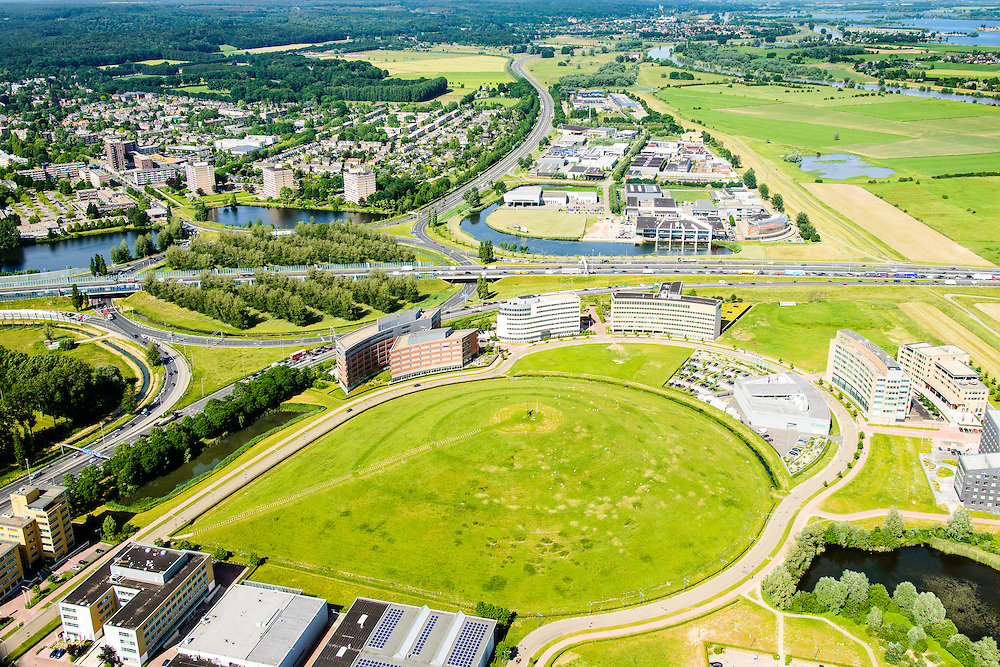 Nederland, Gelderland, Gemeente Arnhem, 09-06-2016;  Bedrijvenpark IJsseloord , in de achtergrond knooppunt Velperbroek, A12 Arnhem Duitsland en A345 en N325.<br /> Velperbroek junction, near Arnhem<br /> luchtfoto (toeslag op standard tarieven);<br /> aerial photo (additional fee required);<br /> copyright foto/photo Siebe Swart