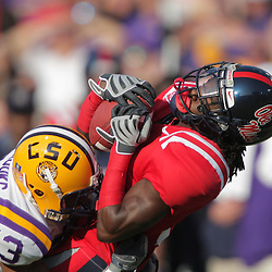 22 November 2008: LSU wide receiver Jordan Newell (13) hits Mississippi cornerback Marshay Green (8) on a punt return during the first half of the NCAA football game between the Ole Miss Rebels and the LSU Tigers at Tiger Stadium in Baton Rouge, LA.