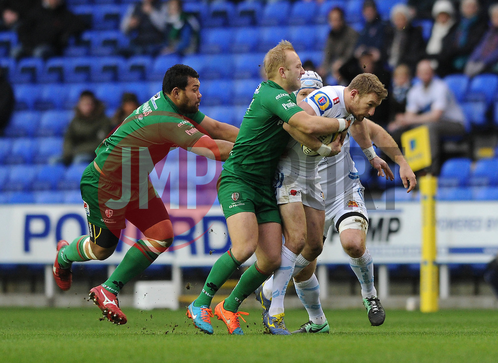 London Irish fly half, Shane Geraghty and London Irish number 8, Ofisa Treviranus tackle Exeter Chiefs' Left Wing, Matt Jess - Photo mandatory by-line: Dougie Allward/JMP - Mobile: 07966 386802 - 11/01/2015 - SPORT - RUGBY - Reading - Madejski Stadium - London Irish v Exeter Chiefs - Aviva Premiership