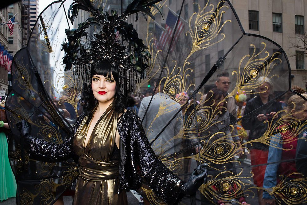 New York, NY - 21 April 2019. A woman with a black headdress and gauzy wings at the Easter Bonnet Parade and Festival on New York's Fifth Avenue.