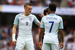 England's Jamie Vardy talks with Raheem Sterling - Mandatory byline: Matt McNulty/JMP - 07966386802 - 22/05/2016 - FOOTBALL - Etihad Stadium -Manchester,England - England v Turkey - International Friendly