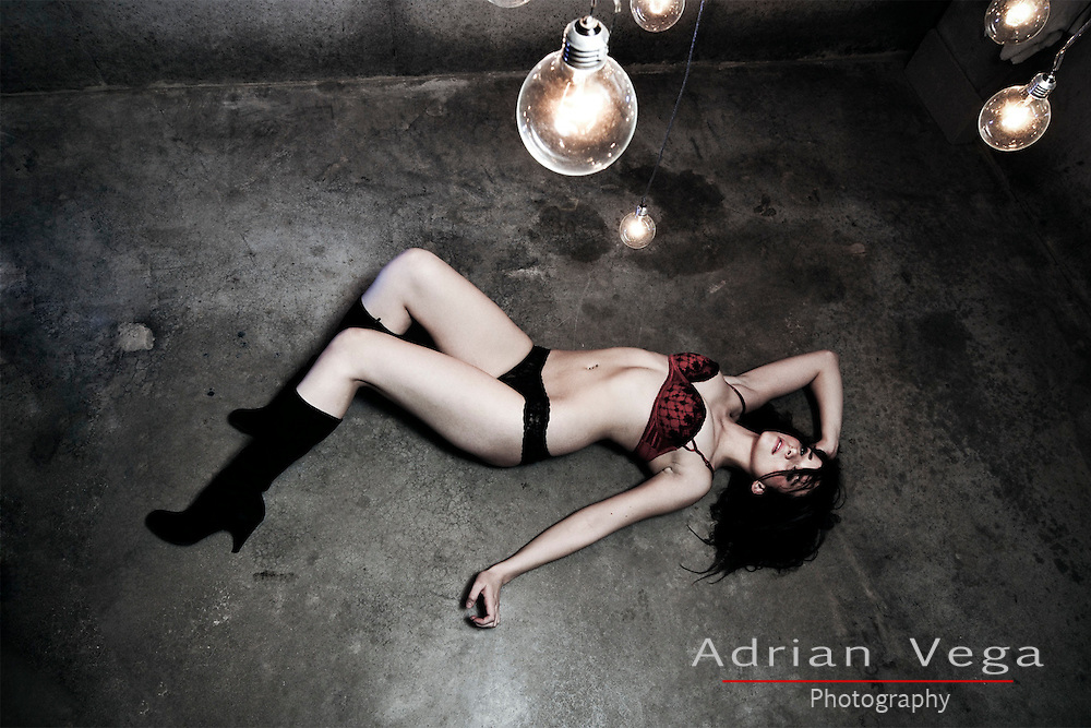 Under the light, Lingerie model in warehouse