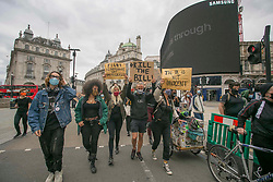 © Licensed to London News Pictures. 29/06/2020. London, UK. Protestors demonstrating against the Immigration Bill in central London. The bill takes control of UK borders and paves the way for a new points-based immigration system. Photo credit: Marcin Nowak/LNP