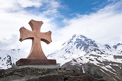 15 June 2016, Kazbegi (Stepantsminda), Georgia: Old stone cross along the pilgrimage up to, and passing by, the dormant stratovolcano of Mount Kazbek and the Gergeti Glacier.