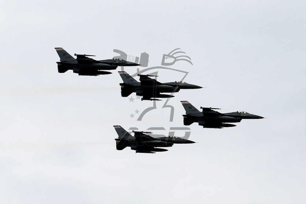 Elkhart Lake,WI - JUN 23, 2012: Military Jets perform a fly over before race action for the  Sargento 200  race at the Road of America in Elkhart Lake , WI.