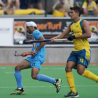 MELBOURNE - Champions Trophy men 2012<br /> India v Austalia <br /> foto: Singh Cahndi and Joel Carrol.<br /> FFU PRESS AGENCY COPYRIGHT FRANK UIJLENBROEK