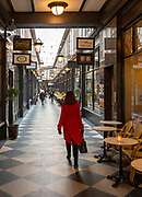 Shoppers walking in High Street arcade in city centre of Cardiff, South Wales, UK