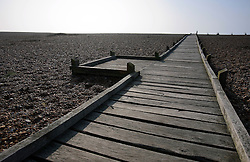 UK ENGLAND DUNGENESS 24MAR12 - Wooden walkway to the shore at Dungeness shingle beach on the Kent coast. It is the  largest area of open shingle in Europe, measuring 12 km by 6 km, which has been deposited by the sea and built up over thousands of years.....jre/Photo by Jiri Rezac....© Jiri Rezac 2012