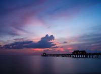 NAPLES, FLORIDA - CIRCA JULY 2018:  Historic Naples Pier in the Gulf of Mexico
