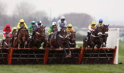 Santini ridden by Nico de Boinville (centre, grey cap) jumps a fence before winning the Doom Bar Sefton Novices' Hurdle during Ladies Day of the 2018 Randox Health Grand National Festival at Aintree Racecourse, Liverpool.