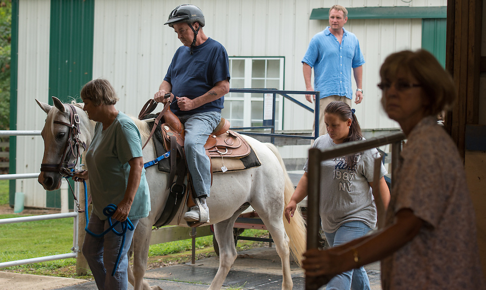 Veteran Ronald Carter participates in a horse therapy program at the Ohio Horse Farm.