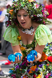 London, July 18th 2015. A woman performs with her blue crystal balls as part of the Busk in London Festival aimed at showcasing the outstanding talents of many of the capital's finest street performers, including, musicians, magicians, living statues and bands.