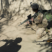 Canadian and Afghan soldiers move toward insurgents taking shelter in a compound during Operation Terrah Toorah in the Siah Choy area in Zhari District located west of Kandahar City, Afghanistan. The operation was a Canadian lead effort in coordination with the Afghan National Army (ANA) and Royal Gurkha Rifles from the British Army. The Zhari district has become well known for insurgent activity and attacks on coalition forces.