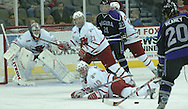 10/20/06 Omaha, NE NIagara University's Les Reaney watches a shot bounce off  University of Nebraska at Omaha's J.P. Platisha while (No.21) Mark Bernier and goalie Jerad Kaufmann at Qwest Center Omaha..(Chris Machian/Prairie Pixel Group)..UNO won in the first game of the Maverick Stampede.