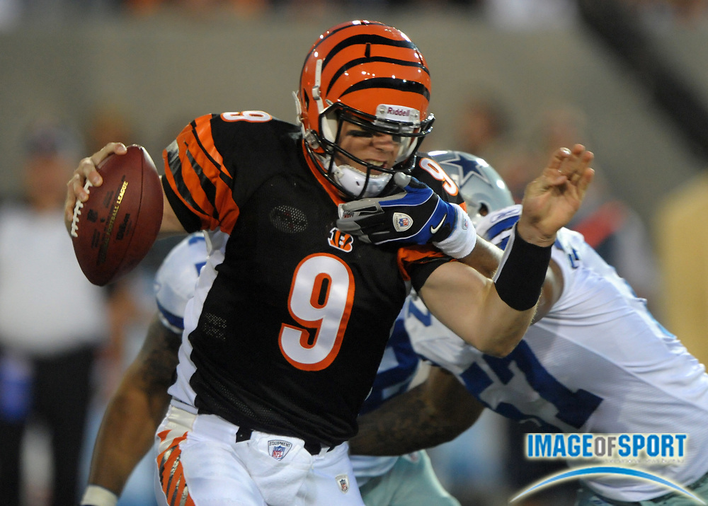 Aug 8, 2010; Canton, OH, USA; Cincinnati Bengals quarterback Carson Palmer (9) is tackled by Dallas Cowboys linebacker Victor Butler (57) during the first quarter of a preseason game at Fawcett Stadium. Photo by Image of Sport
