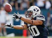 BYU tailback JJ Di Luigi reaches to catch a 21-yard Jake Heaps pass during the first half of an NCAA college football game against UNLV at LaVell Edwards Stadium, Saturday, Nov. 6, 2010, in Provo, Utah.  BYU defeated UNLV 55-7. (AP Photo/Colin E. Braley)