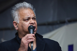 Southall, UK. 27th April 2019. Suresh Grover of Southall Resists and Southall Monitoring Group addresses members of the local community and supporters at a rally outside Southall Town Hall to honour the memories of Gurdip Singh Chaggar and Blair Peach on the 40th anniversary of their deaths. Gurdip Singh Chaggar, a young Asian boy, was the victim of a racially motivated attack whilst Blair Peach, a teacher, was killed by the Metropolitan Police's Special Patrol Group during a peaceful march against a National Front demonstration.