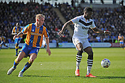 JJ Hooper of Port Vale FC under pressure from Jack Grimmer of Shrewsbury Town during the Sky Bet League 1 match between Shrewsbury Town and Port Vale at Greenhous Meadow, Shrewsbury, England on 25 March 2016. Photo by Mike Sheridan.