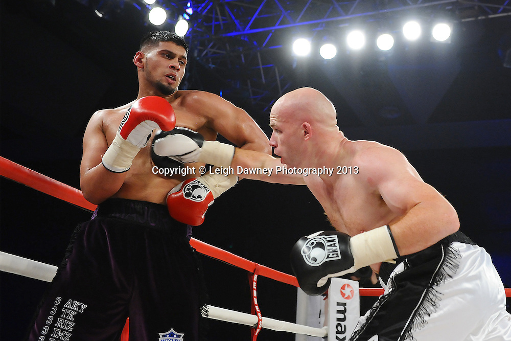 Leon Senior on the attack during his bout with Arfan Iqbal in a Light Heavyweight contest. Glow, Bluewater, Kent, UK. Hennessy Sports © Leigh Dawney Photography 2013.