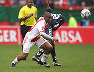 FRANKLIN CALE pushes Richard Gariseb off the ball during the PSL match between Ajax Cape Town and Bidvest Wits held at Newlands Stadium in Cape Town on 13 September2009 ..Photo by Shaun Roy/www.sportzpics.net.+27 21 785 6814..