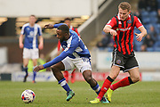 Shrewsbury Town midfielder Bryn Morris challenges with Chesterfield striker  Sylvan Ebanks-Blake for possession during the EFL Sky Bet League 1 match between Chesterfield and Shrewsbury Town at the Proact Stadium, Chesterfield, England on 11 March 2017. Photo by Aaron  Lupton.