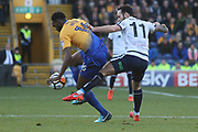 Hayden White of Mansfield Town (16) and Lee Molyneux of Guiseley AFC (11) fight for the ball during the The FA Cup match between Mansfield Town and Guiseley  at the One Call Stadium, Mansfield, England on 3 December 2017. Photo by Mick Haynes.