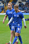 Chris Sedgwick and Andrew Tutte during the Sky Bet League 1 match between Bury and Fleetwood Town at Gigg Lane, Bury, England on 18 August 2015. Photo by Mark Pollitt.